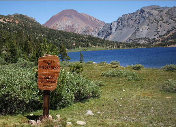 The Hoover Wilderness sign at Summit Lake. The Hoover Wilderness spans 128,000 acres and is managed by the Inyo National Forest and the Humboldt/Toiyabe National Forest mostly in northern California and Nevada. (Photo: Dcrjsr; Wikimedia Commons CC-BY-SA-3.0)
